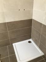 Osazení spchové vaničky - usazení a zapojení sifonu, cena práce za ks