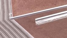 Vnitřní roh pod obklad Cezar přírodní hliník 9mm 2,5m